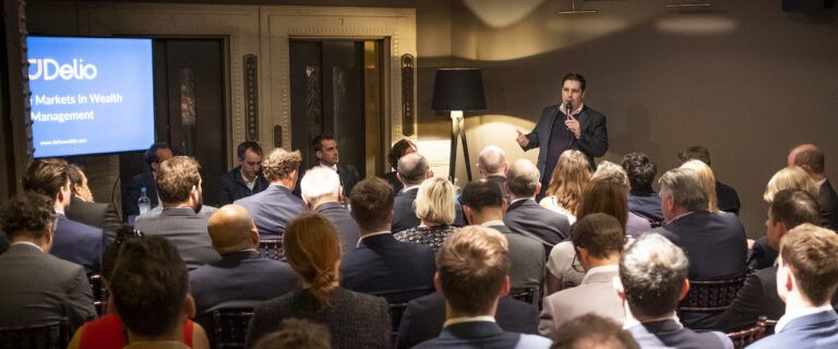 David Newman speaking at a Delio wealth management event